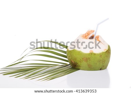 Refreshing green organic coconut fruit juice served with straw on white background