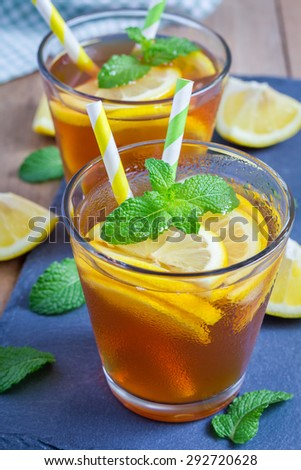 Refreshing homemade lemon iced tea on a black slate tray - stock photo
