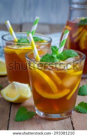 Refreshing homemade lemon iced tea on a wooden table