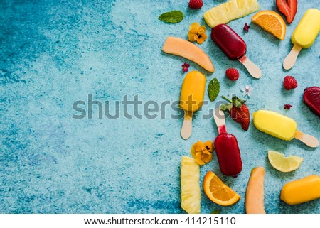 refreshing homemade popsicle from above on slate background with space for text - stock photo