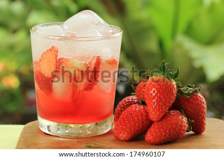 Refreshing Ice Cold Strawberry soda juice on the table