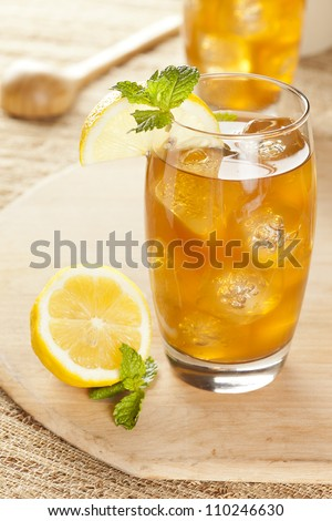 Refreshing Iced Tea with Lemon against a background - stock photo