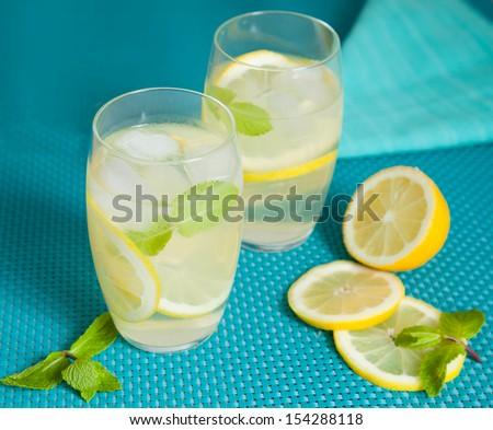 Refreshing lemonade with mint leaves - stock photo