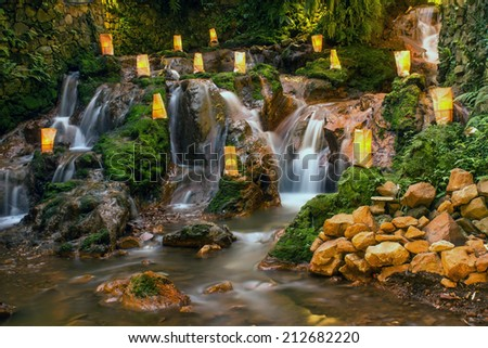 refreshing natural landscape with a waterfall that looks beautiful in a city in Indonesia - stock photo