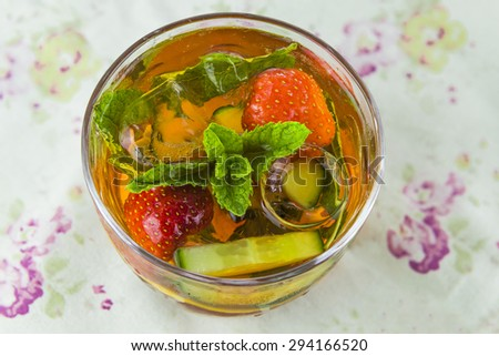 Refreshing Pimms cocktail with lemonade - stock photo