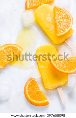 Refreshing popsicle, fruit slices and ice cubes, healthy summer sweet treat - stock photo