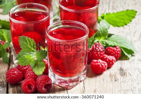 Refreshing raspberry drink with berries and mint, selective focus - stock photo