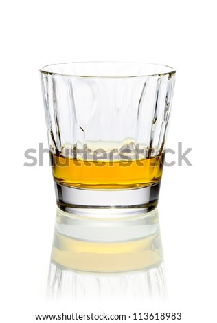 Refreshing relaxing glass of whiskey or brandy in a tumbler on a white background with reflection