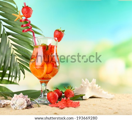 Refreshing strawberry cocktail on sand beach  - stock photo