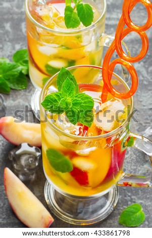 refreshing summer drink Peach Sweet Tea with ice and mint - stock photo