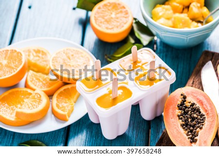 Refreshing treat, exotic fruits lolly, popsicle with ingredients - stock photo