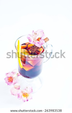 Refreshment beverage in pitcher and glass with fruits and spice isolated on white background - stock photo