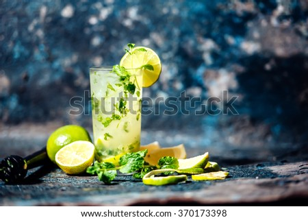 Refreshment cocktail with lime and ice. Mojito drink served at bar, pub or restaurant - stock photo
