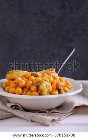 refried beans with chicken and vegetables on the plate - stock photo