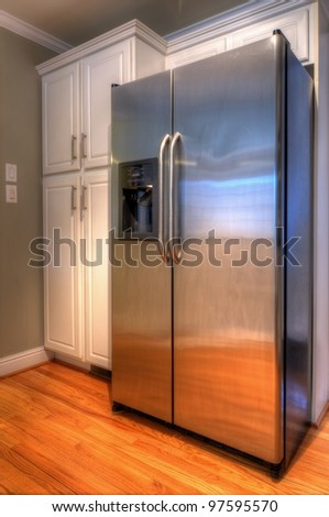 Refrigerator and cabinets - stock photo
