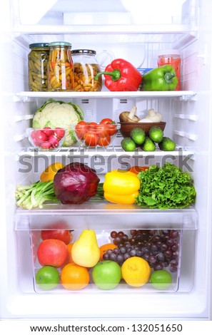Refrigerator full of food - stock photo