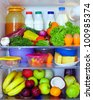 refrigerator full of healthy food. fruits, vegetables and dairy products - stock photo