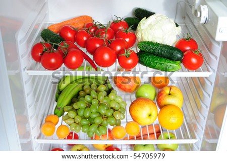 Refrigerator with fruit and vegetables - stock photo
