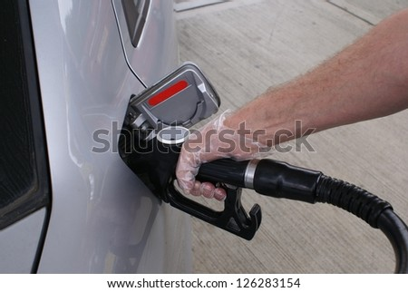 Refueling a car with diesel or petrol