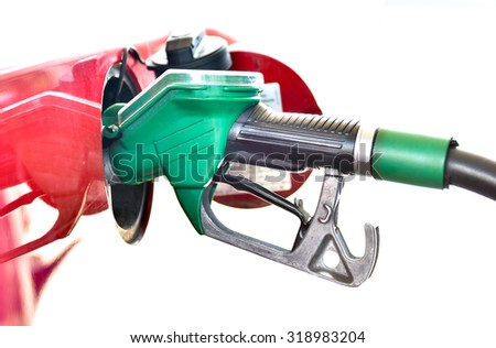 Refueling a red car at the gas station. A truck is being filled with fuel diesel or petrol with green nozzle. Isolated on white. - stock photo