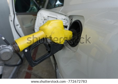 Refueling gasoline fuel in car at gas station
