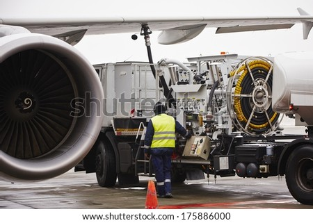 Refueling of the aircraft at the airport. - stock photo