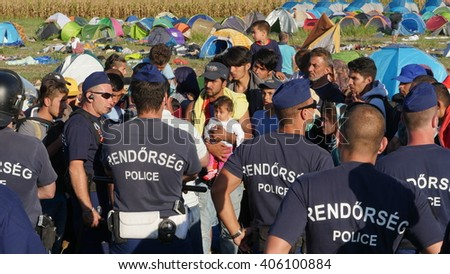 Refugees are prevented from moving further towards the interior of Hungary and are kept surrounded by Hungarian police near Roszke, Hungary on September 8, 2015.