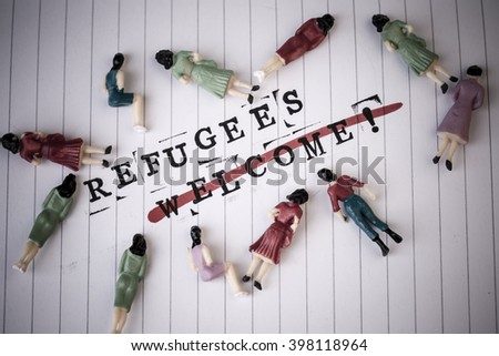 refugees welcome strike through text on white line paper with face off woman figures around - stock photo