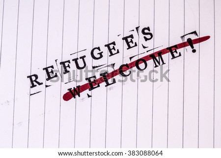 refugees welcome strikethrough text on white line paper - stock photo