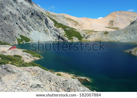 Refugio Italia and Laguna Negra at National Park of Nahuel Huapi, Patagonia, Argentina. - stock photo