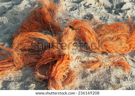 Refuse of fishing nets on the North sea beach - stock photo