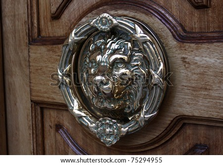 Regal Lion Door Knocker - stock photo