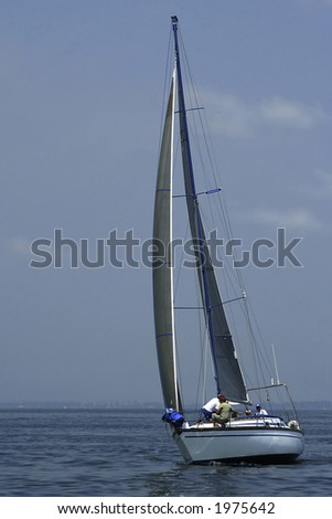 Regatta. Sports. The team of a yacht changes sails. The yacht should be floating faster. - stock photo