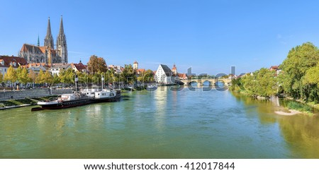Regensburg, Germany. Panoramic view of Danube river with Regensburg Cathedral, Old steamship, Tower of Town Hall, Salt House and Stone Bridge. - stock photo