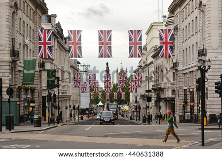Regent Street in London with Union Jack flags above it. June 2016 Regent Street London Celebrating British Queen birthday Union Jacks decorating London street