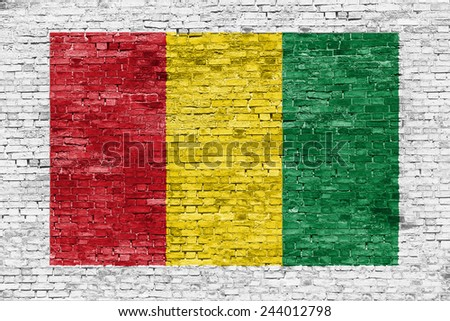 Reggae colors painted over white brick wall - stock photo