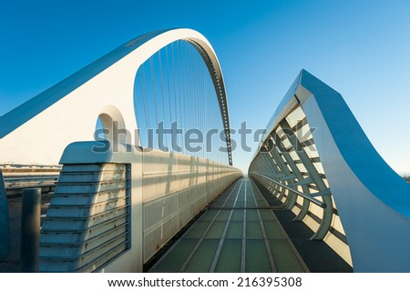 "REGGIO EMILIA, ITALY - FEBRUARY 23, 2014. Famous bridges complex ""Le Vele"" by architect Santiago Calatrava. The central arch of the bridge is 220 meters long and 50 meters high.  - stock photo"