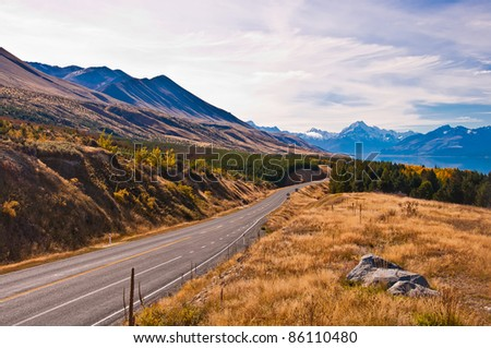 Regional road at Lake Pukaki with Mt. Cook in background (the highest mountain in New Zealand). South Island. New Zealand - stock photo
