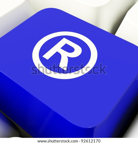 Registered Computer Key In Blue Showing Patent Or Trademark - stock photo