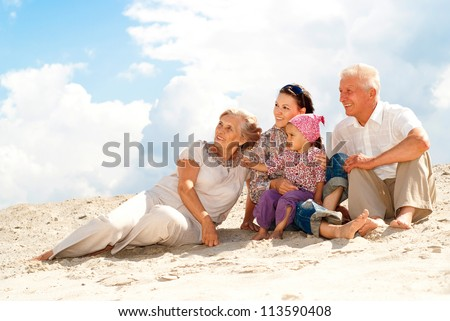 Regular fun weekend spent with their granddaughter - stock photo