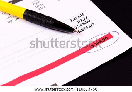 Regular invoice with the pen - stock photo