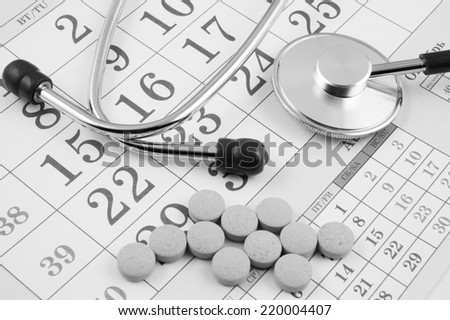 Regular medical examination concept, stethoscope and drugs on calendar