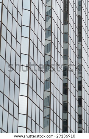 Regular pattern shaped by glass wall of the building - stock photo