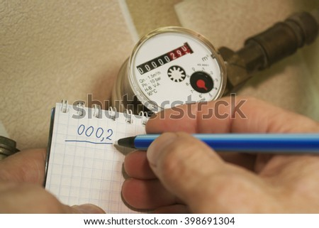 Regularly going flow metering water - stock photo