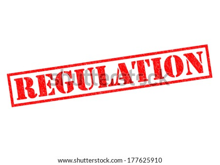 REGULATION red Rubber Stamp over a white background. - stock photo