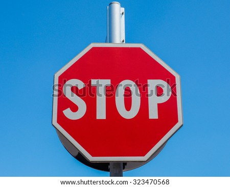 Regulatory signs, Stop traffic sign over the blue sky