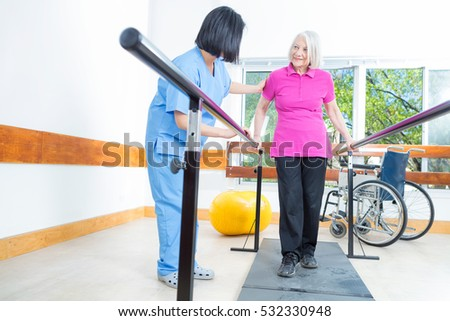 Rehabilitation clinic with elderly people and nurse.