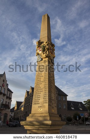 Reichenbach, Germany - August 27, 2015: The old column at the Postplatz in Reichenbach (Vogtland) shows destinations with a price, this marks the required amount of thaler for a transport to the city