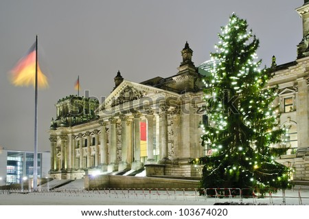 reichstag in berlin in winter at night with christmas tree