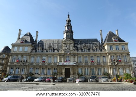 REIMS, FRANCE, August 30 2015: The town hall is seen as a fine example of classic architecture